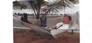 Geoffrey Cann lounging in a hammock with a Toshiba laptop